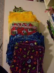 Left over random cuts of fabric form a kid's quilting class