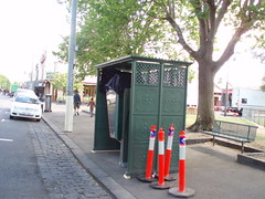 A covered Telstra phone booth