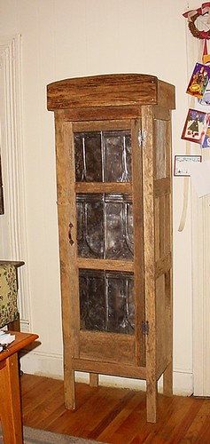 Cabinet with old tins