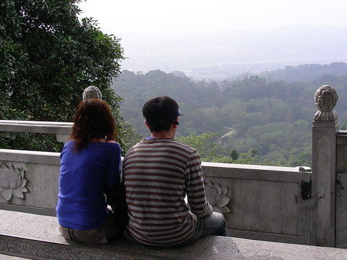 Couple enjoying view in front of Temple near Fei Feng Mountain
