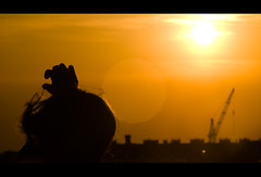 Maria (Sakuto) Tags: people orange woman sun hot yellow landscape hand head panoramic flare jupiter caughtintheact 135mm aplusphoto
