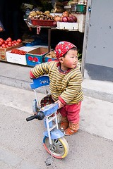 Chinese Child and Trike (Eric Wolfe) Tags: china children beijing bicycles hutongs tricycles chn original:filename=200803200152jpg