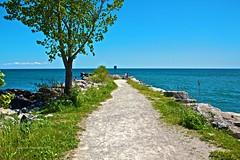 Walk out to Lake Ontario (FaizAsh) Tags: park blue summer portrait sky lake water leaves canon rocks lakeshore jc breeze mississauga archipelago saddington t2i
