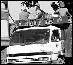 women on truck b+w (LindsayStark) Tags: travel blackandwhite haiti war carribean conflict humanrights humanitarian humanitarianaid emergencyrelief waraffected