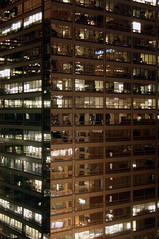 Office building In the Loop, Chicago. (travelmatt) Tags: usa chicago reflection tower window night skyscraper lights loop officebuilding il statestreet peeping lookingthroughwindows lpwindows