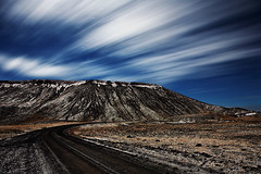 Around the bend (LalliSig) Tags: road blue winter sky orange cloud brown mountain snow motion cold nature rock night clouds dark stars landscape outdoors iceland rocks frost nightscape mud outdoor hill ground hills gravel