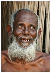 So What? [..Jhenaidah, Bangladesh..] (Catch the dream) Tags: old portrait smile rural beard village spirit bongo content aged farmer bengal bangladesh bangla bengali bangladeshi bangali catchthedream gettyimagesbangladeshq2