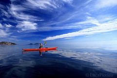 Floating calmly (LucaPicciau) Tags: sardegna sea sky reflection kayak mare sardinia floating calm cielo lp canoa glassy olbia gallura lupi calmly ceraso loiri picciau