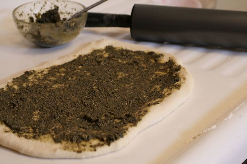 Pesto spread out on dough