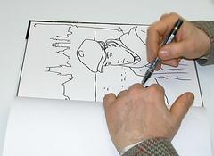 mani di Giardino mentre disegna Jonas Fink - photo Goria - click