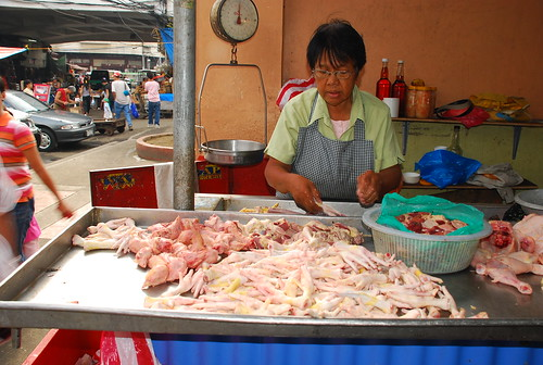Manila Market chicken bits and pieces for sale, feet, head, liver, vendor, market adidas helmet Buhay Pinoy Philippines Filipino Pilipino  people pictures photos life Philippinen  walkman