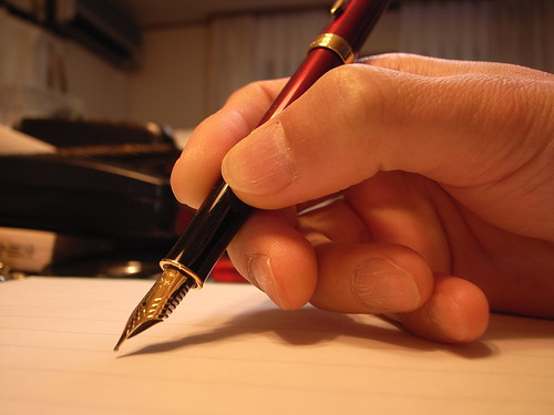 In writing [Photo by matsuyuki] (CC BY-SA 3.0)