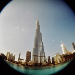 Burj Khalifa fisheye (sonofwalrus) Tags: دبي الإماراتالعربيةالمتحدة holga film lomo lomography scan uae unitedarabemirates dubai burjkhalifa tower fisheye architecture building middleeast