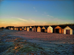 Beach huts in the sunset (pics by paula) Tags: blue sunset sky beach by photoshop nikon pics sandy huts paula software elements coolpix pse topaz adjust