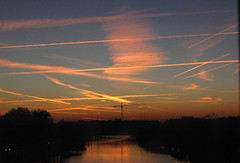 Streaked (rkarla_lim) Tags: pink light reflection sunrise dawn jet planes streaks