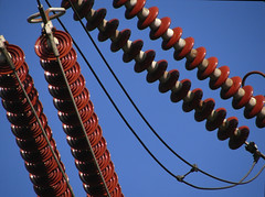 Power to the Red People. (archidave) Tags: blue red electric ceramic power dynamic angle insulation bluesky pylon chain cables electricity curve insulators