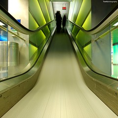 three girls and an escalator (Toni_V) Tags: city longexposure motion blur green topv111 d50 schweiz switzerland movement nikon europe zurich escalator perspective sigma1020mm shopville toniv artlibre superhearts theperfectphotographer toniv ostrellina 071027 visionqualitygroup