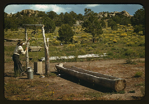 Faro Caudill drawing water from his well, Pie Town, New Mexico (LOC)