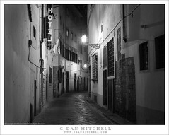 Hotel, Narrow Street (G Dan Mitchell) Tags: florence firenze italy tuscany blackandwhite monochrome narrow twisting street old lights cobbles curve travel photography night sign