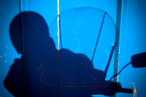 Biker Chick - my silhouette against a blue dumpster in Stayton Oregon