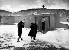 Congregation leaving after mass (John Collier Jr.) Tags: blackandwhite bw usa history classic film museum america vintage collier us photographer unitedstates propaganda wwii documentary patriotic roosevelt historic professional worldwarii 1940s archives maxwell ww2 americana civildefense patriotism archival forties largeformat anthropology homefront worldwar2 40s fsa wartime newdeal owi waryears farmsecurityadministration officeofwarinformation johncollierjr geo:location=trampasnm newmexicostories