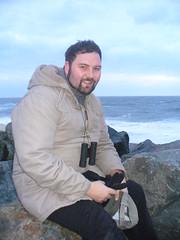 Happy New year 2008! (sam2cents) Tags: ireland sea man beach me stone beard rocks waves boulders binoculars wicklow crests irishsea naturalist duffelcoat whitehorses sam2cents samconnollynaturalist