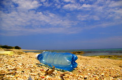 ...une bouteille  la mer... (gicol) Tags: sea beach bottle mare dirt pollution environment puglia ambiente sporco apulia inquinamento