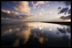 Skyscape (Mark Emirali) Tags: ocean light sea newzealand sky cloud reflection beach canon dark landscape explore nz land frontpage 1022mm 30d copyrighted whatipu canon30d landofthelongwhitecloud pleasedonotusewithoutmypermission seascaps maloe4 cloudonsand maloephoto maloephotography markemirali