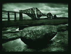 Big Rock (Doug_Cook) Tags: bridge rock landscape scotland big skies shoreline victorian stormy forth duotone drama southqueensferry flickrsbest nv10 platinumphoto anawesomeshot aplusphoto diamondclassphotographer dapagroupmeritaward scenicsnotjustlandscapes