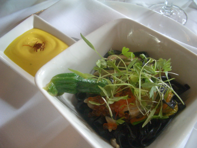 Squid ink linguini with Black Mussels and zucchini flowers