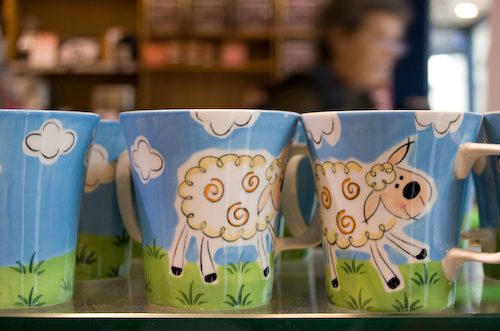 Image of three coffee mugs that playfully make a sheep