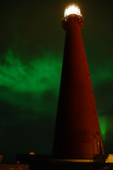 The Andenes lighthous (Tony Gulla) Tags: winter light red sky mountain snow color green nature norway night landscape geotagged norge vinter nikon himmel aurora nordic northern rd natt nord fyr fjell borealis sn sne andenes andya winterlandscape landskap vesterlen grnn hous nordlys andoy nordland rdt vesteralen andy andoya lighthous sny fyrlykt arvitecture