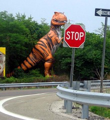 Stop for Dinos (moonjazz) Tags: road trip orange smile sign mystery kids danger america happy stripes teeth humor stripe tourist stop curve trex kitch attraction distraction dinosour canivour