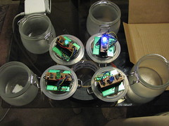 Really, there weren't many construction photos to take, but here's the garden lamp guts being epoxied to the jar lids.