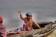 Tonle Sap_Girl in Boat (JFlewellen) Tags: water birds river children fishing cambodia tonlesap boaters commontern hardlife
