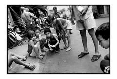 marble game (fly) Tags: film blackwhite asia vietnam fly simonkolton