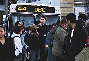 UBC students wait to board the bus