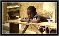 La petite du banc (Laurent.Rappa) Tags: voyage africa unicef travel portrait people face children child retrato laurentr enfant ritratti ritratto regard côtedivoire peuple afrique ivorycoast blueribbonwinner ivorycost funfanphotos laurentrappa