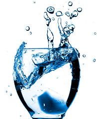 Disturbance (fadi3) Tags: blue ontario canada ice water glass d50 nikon stock nikond50 backlit wineglass top10 splash dslr highspeed 2007 stopmotion splish sb24 cotcpersonalfavorite 18135mm strobist flickrspecial aplusphoto flickrhearts amazingshots heartawards fadi3
