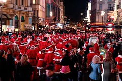 Santas on the move (Dean Ayres) Tags: red london hat festive santas piccadillycircus fatherchristmas santacon santaclause coventrystreet