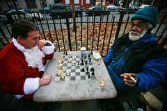checkmate (sgoralnick) Tags: santa xmas nyc holiday newyork drunk costume santas chess santaclaus santacon canon5d mayhem tompkinssquarepark santarchy barcrawl canon1635mmf28l santaconnyc santacon2007 santacon07 canonef1635mmf28liiusm