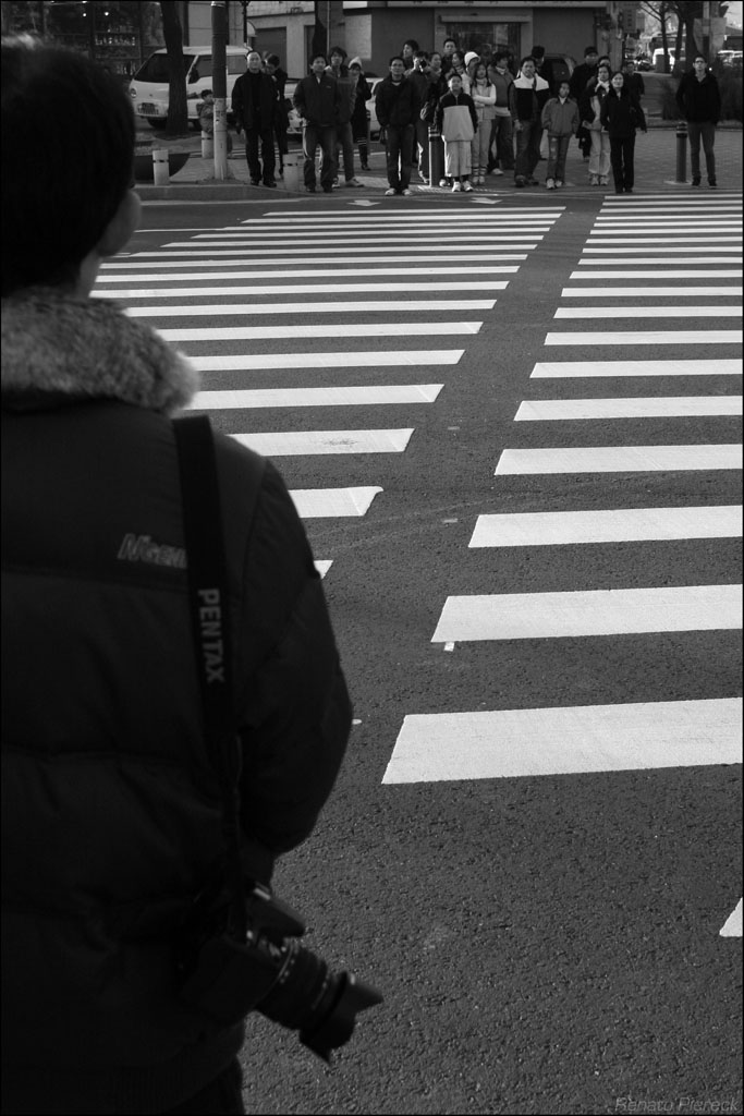 pentax dude about to cross the road