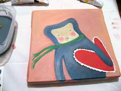 after the green scarf, pink cheeks, face, and heart painting