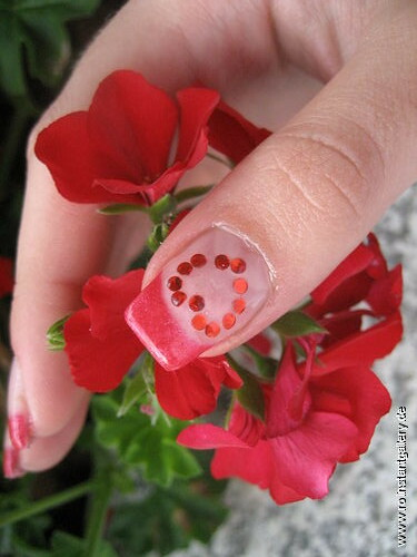 nail art red heart design holding flower