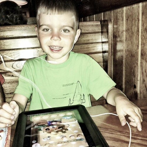 Project 365 157/365: Angry Kid, the iPad, and dinner at Outback Steakhouse tonight.