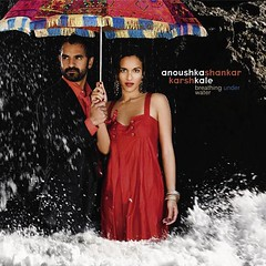 Breathing Under Water (nm_dan) Tags: music india beach water rain umbrella album cd indian wave foam karshkale anoushkashankar breathingunderwater