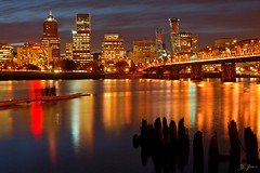 Hustle Bustle (Dan Sherman) Tags: city bridge skyline river portland downtown nightshot citylights hawthornebridge highrise pdx portlandoregon hawthorne willametteriver downtownportland portlandwaterfront portlandbridges amazingtalent waterfrontcity bridgeatnight webshow portlandbridge downtownportlandoregon