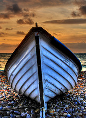 beached 1 (petervanallen) Tags: sunset sea beach night clouds portland coast boat pebbles dorset hdr jurassic chesil 3exp thegoldendreams