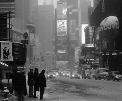 Times Square Snow (John Fraissinet) Tags: street nyc newyorkcity urban blackandwhite snow ny newyork ice silhouette interesting traffic wind streetphotography windy timessquare jvc blueribbonwinner johnfraissinet streetobservationscom johnfraissinet