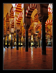 A Forest of Slender Columns (tochis) Tags: history architecture spain muslim columns arches mosque mezquita marble es andalusia crdoba striped islamic poorlight withouttripod 25faves mywinners aplusphoto